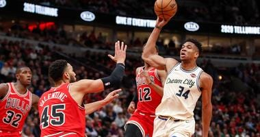 Bucks forward Giannis Antetokounmpo (34) drives to the basket against Bulls guard Denzel Valentine (45).