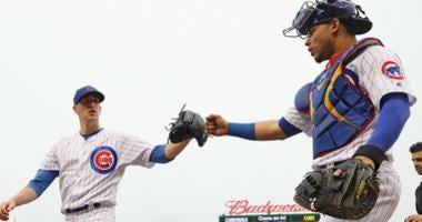 Cubs right-hander Kyle Hendricks, left, is congratulated by catcher Willson Contreras.