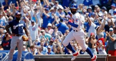 Cubs outfielder Jason Heyward rounds the bases after homering.