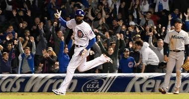 Cubs outfielder Jason Heyward rounds the bases after hitting a walk-off homer against the Marlins.