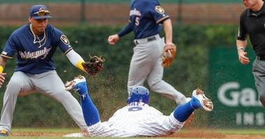 Cubs shortstop Javier Baez (9) steals second base as the tag of Brewers shortstop Orlando Arcia (3) is late.