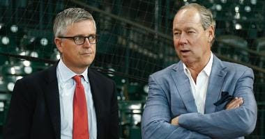 Then-Astros general manager Jeff Luhnow, left, and owner Jim Crane talk ahead of a game in 2017.