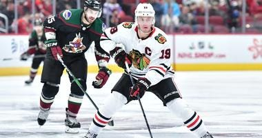 Blackhawks center Jonathan Toews (19) carries the puck as Coyotes center Brad Richardson (15) defends.