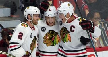 From left, Duncan Keith, Patrick Kane and Jonathan Toews celebrate Kane's goal that lifted the Blackhawks to a win.