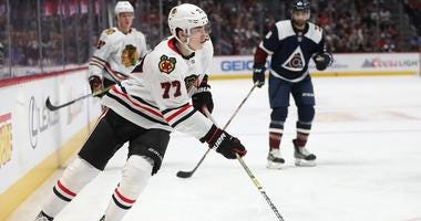 Blackhawks forward Kirby Dach handles the puck against the Avalanche.