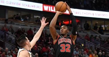 Bulls guard Kris Dunn (32) shoots the ball over Pacers guard T.J. McConnell (9).