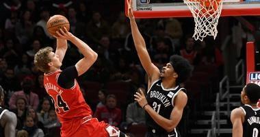 Bulls forward Lauri Markkanen (24) shoots over Nets center Jarrett Allen (31).