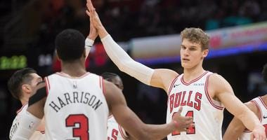 Bulls forward Lauri Markkanen (24) celebrates with teammates.