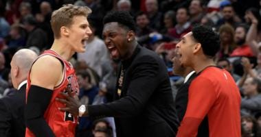 Bulls forward Lauri Markkanen (24) celebrates with his teammates after his winning layup against the Thunder.