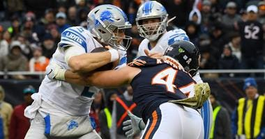 Bears inside linebacker Nick Kwiatkoski (44) sacks Lions quarterback Jeff Driskel (2).