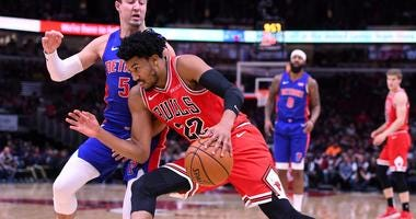 Bulls forward Otto Porter Jr. (22) dribbles the ball against Pistons guard Luke Kennard (5).