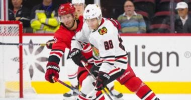 Blackhawks right wing Patrick Kane (88) skates with the puck against Hurricanes center Jordan Staal (11).