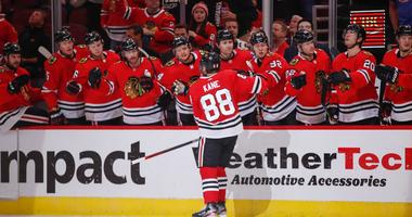 Blackhawks right wing Patrick Kane (88) celebrates with teammates after scoring a goal against the Edmonton Oilers.