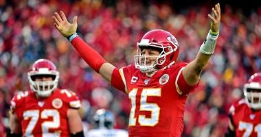 Chiefs quarterback Patrick Mahomes celebrates after throwing a touchdown against the Titans in the AFC Championship Game.