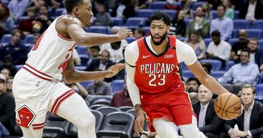 Pelicans forward Anthony Davis, right, drives on the Bulls.