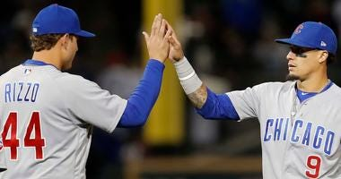 Anthony Rizzo, let, celebrates with Cubs teammate Javier Baez after a win.