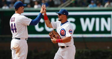 Anthony Rizzo, left, celebrates with Cubs teammate Kyle Schwarber after a win.