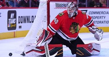 Blackhawks goalie Robin Lehner makes a save against the Jets.