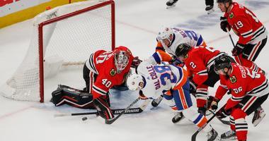 Islanders left wing Michael Dal Colle (28) tries to score against Blackhawks goaltender Robin Lehner (40).