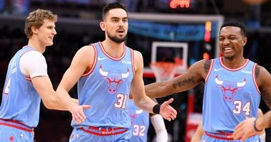 Bulls guard Tomas Satoransky (31) reacts with center Wendell Carter Jr. (34) and forward Lauri Markkanen (24) after making a basket.