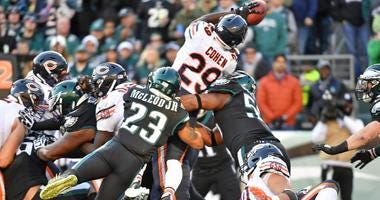 Eagles free safety Rodney McLeod (23) and defensive end Brandon Graham (55) stop Bears running back Tarik Cohen (29) at the goal line.