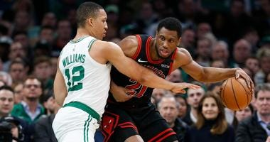 Bulls forward Thaddeus Young (21) is defended by Celtics forward Grant Williams (12).