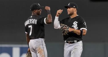 Tim Anderson, left, and White Sox teammate Yoan Moncada congratulate one another.