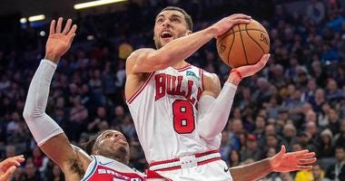 Bulls guard Zach LaVine (8) goes up for the shot against Kings guard Buddy Hield (24).