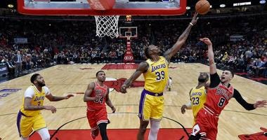 Lakers center Dwight Howard (39) blocks the shot of Bulls guard Zach LaVine (8).