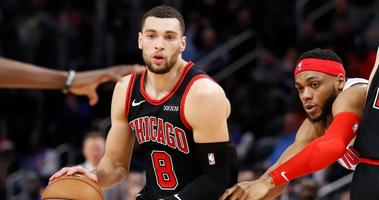 Bulls guard Zach LaVine (8) dribbles the ball against Pistons guard Bruce Brown (6).