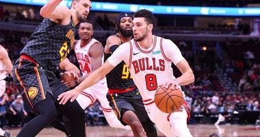 Bulls guard Zach LaVine (8) drives on Hawks center Alex Len (25).