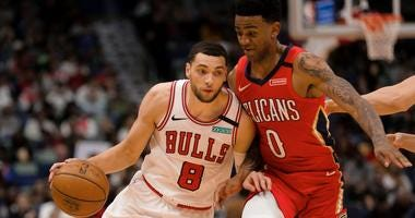 Bulls guard Zach LaVine (8) drives past Pelicans guard Nickeil Alexander-Walker (0).