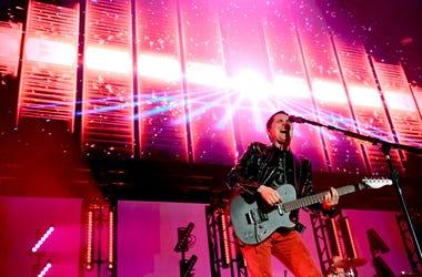 Matt Bellamy of Muse performs on stage