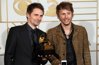 Matt Bellamy (left) and Dominic Howard of Muse pose in the photo room with their award for Best Rock Album for Drones during the 58th Grammy Awards at the Staples Center