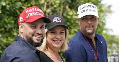 Tirso Luis, left, Ana Paez, and German Pinelli, right, members of the band Los 3 de la Habana, pose for a photograph, Thursday, Oct. 22, 2020, in Miami. The Cuban artists, who sought asylum in the U.S., have composed a salsa song in support of Trump.