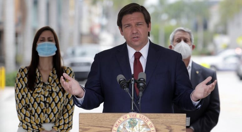 Florida Gov. Ron DeSantis speaks at a news conference during the new coronavirus pandemic, Thursday, May 14, 2020, in Doral, Fla. DeSantis has signed an executive order for the reopening of Miami-Dade and Broward counties on May 18.