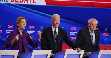 Sen. Elizabeth Warren (D-MA) speaks as former Vice President Joe Biden and Sen. Bernie Sanders (I-VT) (R) listen during the Democratic presidential primary debate at Drake University on January 14, 2020 in Des Moines, Iowa.