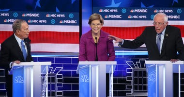 Democratic presidential candidates former New York City mayor Mike Bloomberg (L), and Sen. Elizabeth Warren (D-MA) listen as Sen. Bernie Sanders (I-VT) makes a point during the Democratic presidential primary debate at Paris Las Vegas on February 19, 2020