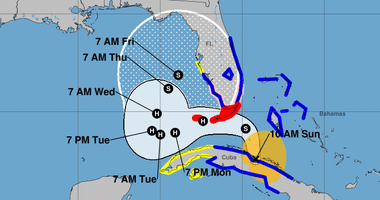 Tropical Storm Eta forecast to become a hurricane, then gradually weaken as the storm drifts north along the Florida west coast.