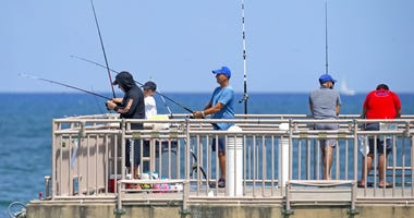 People fishing at the Newport Fishing Pier in Sunny Isles Beach as the coronavirus pandemic continues on Sunday, Sept. 6, 2020.