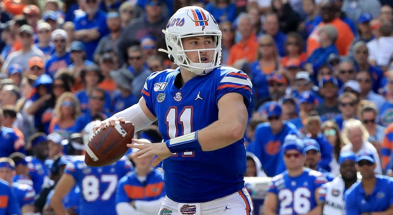 Kyle Trask #11 of the Florida Gators attempts a pass during the game against the Vanderbilt Commodores at Ben Hill Griffin Stadium on November 09, 2019 in Gainesville.