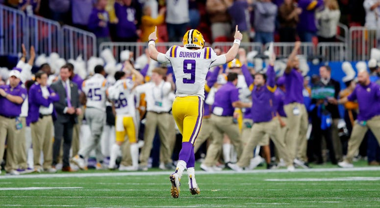 Quarterback Joe Burrow #9 of the LSU Tigers celebrates a 62 yard touchdown over the Oklahoma Sooners during the Chick-fil-A Peach Bowl at Mercedes-Benz Stadium on December 28, 2019 in Atlanta, Georgia.