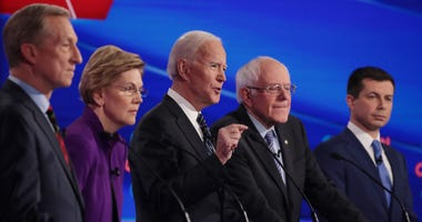 Tom Steyer (L), Sen. Elizabeth Warren (D-MA), Sen. Bernie Sanders (I-VT) and former South Bend, Indiana Mayor Pete Buttigieg (R) listen as former Vice President Joe Biden (C) speaks during the Democratic presidential primary debate at Drake University.