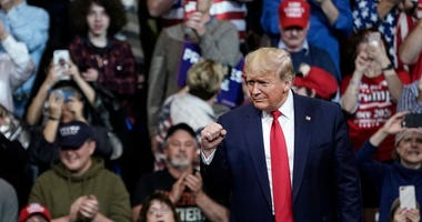 "Supporters cheer as U.S. President Donald Trump arrives for a ""Keep America Great"" rally at Southern New Hampshire University Arena on February 10, 2020 in Manchester, New Hampshire."