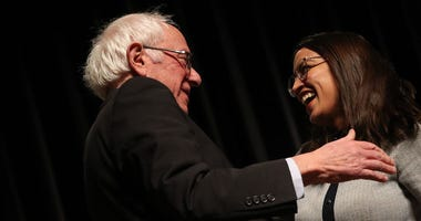 Democratic presidential candidate Sen. Bernie Sanders (I-VT) is greeted by Rep. Alexandria Ocasio-Cortez (D-NY) after she introduced him at a campaign event at the Ames City Auditorium on January 25, 2020 in Ames, Iowa.
