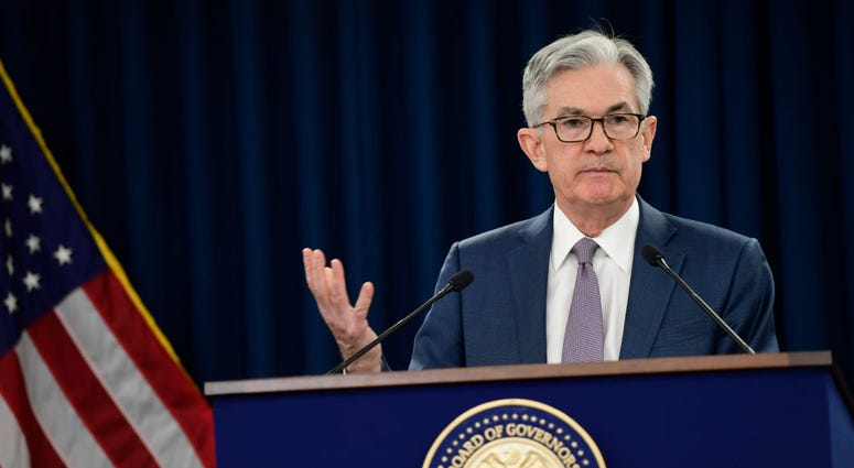 Federal Reserve Chair Jerome H. Powell announces a half percentage point interest rate cut
