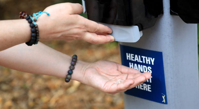 A detail as a fan uses hand sanitizer during a practice round prior to The PLAYERS Championship on The Stadium Course at TPC Sawgrass on March 10, 2020 in Ponte Vedra Beach, Florida.