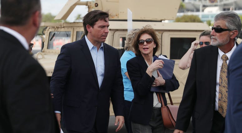 Florida Gov. Ron DeSantis attends a news conference in the Hard Rock Stadium parking lot in Miami Gardens, Florida.
