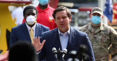 Florida Gov. Ron DeSantis gives updates about the state's response to the coronavirus pandemic during a press conference in Fort Lauderdale, Florida.