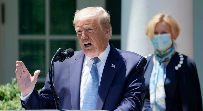 U.S. President Donald Trump is joined by Dr. Deborah Brix, White House coronavirus response coordinator while speaking about coronavirus vaccine development in the Rose Garden of the White House
